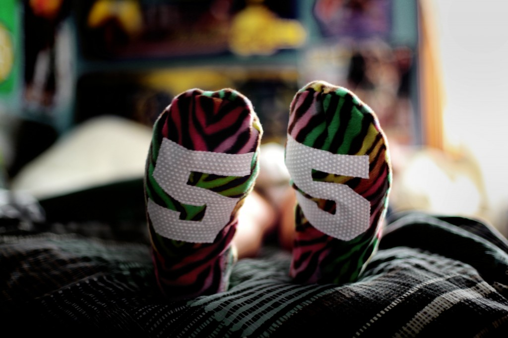 Manly Guys Redefining Masculinity with Animal Print Fleece Slippers using Green Pepper Pattern and Jiffy Grip Leopard, Giraffe, Zebra Rainbow Print